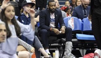 Washington Wizards' John Wall (2) sits on the bench during a timeout in the second half of the team's NBA basketball game against the Boston Celtics, Tuesday, April 9, 2019, in Washington. The Celtics won 116-110. (AP Photo/Nick Wass) ** FILE **