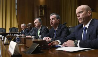 Prime Therapeutics Senior Vice President, General Counsel, and Interim President and Chief Executive Officer Mike Kolar, right, testifies before the Senate Finance Committee on Capitol Hill in Washington, Tuesday, April 9, 2019, during a hearing to explore the high cost of prescription drugs. He is joined at the table by, from left, Cigna Corporation Executive Vice President and Chief Clinical Officer Steve Miller, CVS Caremark President and CVS Health Executive Vice President Derica Rice, Humana Healthcare Services Segment President William Fleming and OptumRx Chief Executive Officer John Prince. (AP Photo/Susan Walsh)