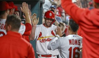 St. Louis Cardinals' Paul Goldschmidt is congratulated by teammates after hitting a solo home run during the fifth inning of the team's baseball game against the Los Angeles Dodgers on Tuesday, April 9, 2019, in St. Louis. (AP Photo/Scott Kane)