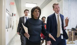 House Financial Services Committee Chair Maxine Waters, D-Calif., following a hearing on violations of the Fair Housing Act where she mentioned a 1973 housing discrimination investigation conducted by the Justice Department against Donald Trump, on Capitol Hill in Washington, Tuesday, April 2, 2019. (AP Photo/J. Scott Applewhite)
