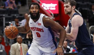 Detroit Pistons center Andre Drummond (0) drives on Memphis Grizzlies center Tyler Zeller (45) in the first half of an NBA basketball game in Detroit, Tuesday, April 9, 2019. (AP Photo/Paul Sancya)