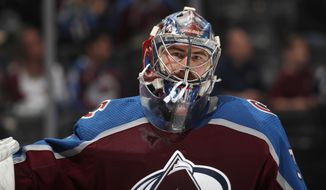 FILE - In this Wednesday, March 27, 2019, file photo, Colorado Avalanche goaltender Philipp Grubauer takes a break in the second period of an NHL hockey game against the Vegas Golden Knights, in Denver. Once the backup, goaltender Philipp Grubauer has stepped in and helped save the Colorado Avalanche season. He went 7-0-2 down the stretch as the Avs earned the last wild-card playoff spot in the West. (AP Photo/David Zalubowski, File)
