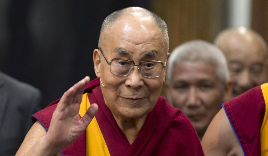 """In this Sept. 15, 2018, file photo, Tibetan spiritual leader the Dalai Lama greets journalists during the opening of the exhibition titled """"Buddha's Life"""" at the Nieuwe Kerk church in Amsterdam, Netherlands. (AP Photo/Peter Dejong, File)"""