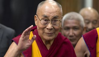"In this Sept. 15, 2018, file photo, Tibetan spiritual leader the Dalai Lama greets journalists during the opening of the exhibition titled ""Buddha's Life"" at the Nieuwe Kerk church in Amsterdam, Netherlands. (AP Photo/Peter Dejong, File)"
