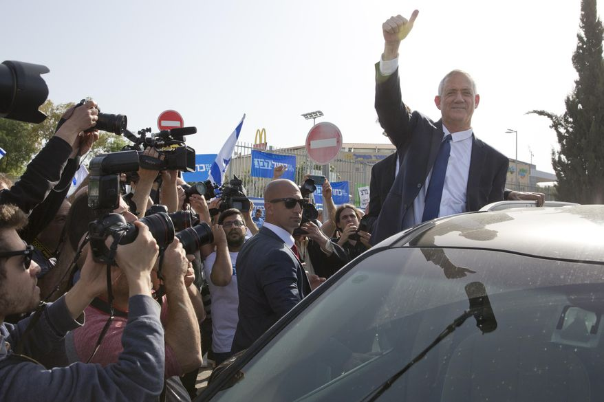 Blue and White party leader Benny Gantz gives thumb up to his supporters after casting vote during Israel's general elections in Rosh Haayin, Israel, Tuesday, April 9, 2019. (AP Photo/Sebastian Scheiner)