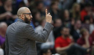 New York Knicks coach David Fizdale gestures during the first half of the team's NBA basketball game against the Chicago Bulls on Tuesday, April 9, 2019, in Chicago. (AP Photo/Kamil Krzaczynski)