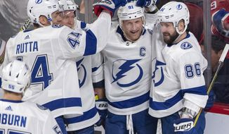Tampa Bay Lightning center Steven Stamkos, second from right, celebrates with teammates after scoring the first goal during the first period of an NHL hockey game against the Montreal Canadiens, Tuesday, April 2, 2019 in Montreal. (Ryan Remiorz/The Canadian Press via AP)