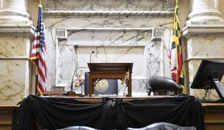 A black cloth trims the speaker's rostrum in the Maryland House of Delegates chamber in Annapolis, Md., Monday, April 8, 2019, the final day of the state's 2019 legislative session. Michael Busch, the longest-serving Maryland House speaker, died Sunday, April 7, 2019. (AP Photo/Steve Ruark)