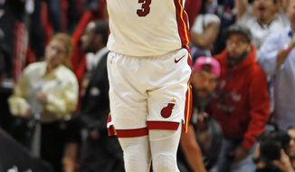Miami Heat guard Dwyane Wade (3) runs up the court to celebrate the win against the Dallas Mavericks at an NBA basketball game, Thursday, March 28, 2019, in Miami. The Heat beat the Mavericks 105-99. (AP Photo/Joel Auerbach)