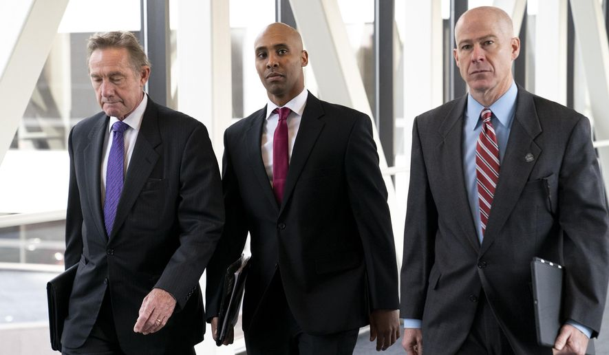 Former Minneapolis police officer Mohamed Noor, center, arrives for the first day of jury selection with his attorneys Peter Wold, left, and Thomas Plunkett, at the Hennepin County Government Center in Minneapolis, Minn., on Monday, April 1, 2019. (Renee Jones Schneider/Star Tribune via AP)