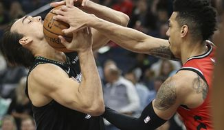 Minnesota Timberwolves' Dario Saric fights for possession of the ball against Toronto Raptors' Danny Green in the first half of an NBA basketball game Tuesday April 9, 2019, in Minneapolis. (AP Photo/Stacy Bengs)