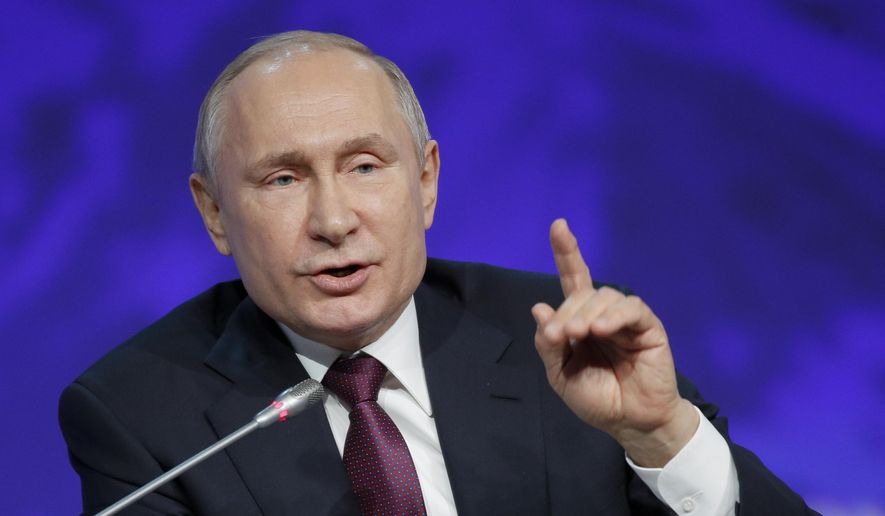 Russian President Vladimir Putin gestures while speaking at a plenary session of the International Arctic Forum in St. Petersburg, Russia, Tuesday, April 9, 2019. (AP Photo/Dmitri Lovetsky)