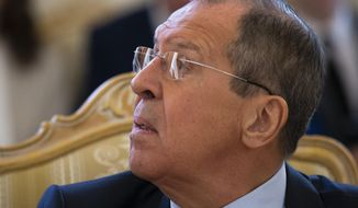 In this file photo, Russian Foreign Minister Sergey Lavrov looks toward an interpreter's booth during his talks with Spanish Fernando Arias, Director-General of the Organisation for the Prohibition of Chemical Weapons (OPCW) in Moscow, Russia, Tuesday, April 2, 2019. (AP Photo/Alexander Zemlianichenko) **FILE**
