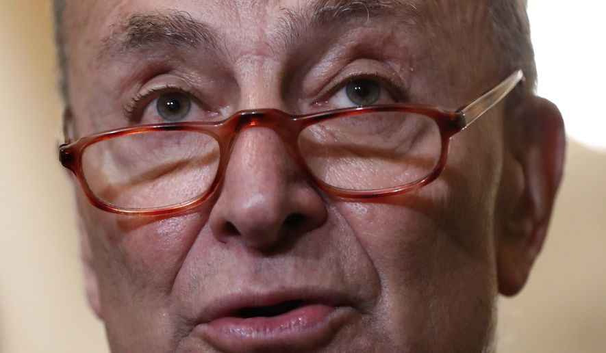 Senate Minority Leader Sen. Chuck Schumer of N.Y., speaks to members of the media following a Senate policy luncheon, Tuesday, April 2, 2019, on Capitol Hill in Washington. (AP Photo/Patrick Semansky)