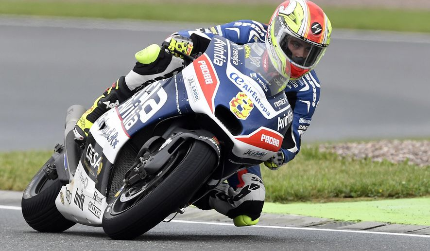 FILE - In this July 17, 2016 file photo, Hector Barbera from Spain goes through a curve during the MotoGP race on the Sachsenring in Hohenstein-Ernstthal, Germany. Former MotoGP rider Hector Barbera complained that his team didn't have enough money to give him a new engine for the Sunday April 7, 2019 World Supersport race at the Motorland circuit in Aragon, Spain and then the team reported Sunday morning that Barbera's bike went missing from the garage. The police was called and an investigation is underway with team owner Imre Toth implying that Hector might have been involved in the bike's disappearance. (AP Photo/Jens Meyer, File)