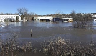 In this undated March 2019 photo provided by Henry Red Cloud, shows flooding on Cloud's Lakota Solar Enterprises property on the Pine Ridge Reservation in southern South Dakota. Red Cloud estimates flood damage at $250,000. Plains and Midwest states are bracing for another massive winter storm Wednesday and Thursday and the prospect of renewed flooding when the snow melts. (Henry Red Cloud via AP)