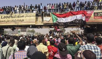 Protesters rally near the military headquarters, Tuesday, April 9, 2019, in the capital Khartoum, Sudan. Activists behind anti-government protests in Sudan say security forces have killed at least seven people, including a military officer, in another attempt to break up the sit-in outside the military headquarters in Khartoum. A spokeswoman for the Sudanese Professionals Association, said clashes erupted again early Tuesday between security forces and protesters who have been camping out in front of the complex in Khartoum since Saturday. (AP Photo)