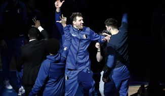 Dallas Mavericks' Dirk Nowitzki (41) is introduced for the team's NBA basketball game against the Phoenix Suns in Dallas, Tuesday, April 9, 2019. (AP Photo/Tony Gutierrez)
