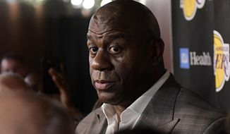 Magic Johnson speaks to reporters prior to an NBA basketball game between the Los Angeles Lakers and the Portland Trail Blazers on Tuesday, April 9, 2019, in Los Angeles. Johnson abruptly quit as the Lakers' president of basketball operations Tuesday night, citing his desire to return to the simpler life he enjoyed as a wealthy businessman and beloved former player before taking charge of the franchise just over two years ago. (AP Photo/Mark J. Terrill) ** FILE **