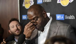 Magic Johnson wipes his eyes as he speaks to reporters prior to an NBA basketball game between the Los Angeles Lakers and the Portland Trail Blazers on Tuesday, April 9, 2019, in Los Angeles. Johnson abruptly quit as the Lakers' president of basketball operations Tuesday night, citing his desire to return to the simpler life he enjoyed as a wealthy businessman and beloved former player before taking charge of the franchise just over two years ago. (AP Photo/Mark J. Terrill) **FILE**