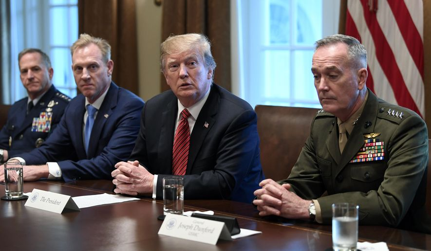President Donald Trump, second from right, flanked by acting Defense Secretary Patrick Shanahan, second from left, and Chairman of the Joint Chiefs of Staff Gen. Joseph Dunford, right, speaks during a meeting with military leaders in the Cabinet Room of the White House in Washington, Wednesday, April 3, 2019. At left is Air Force Chief of Staff Gen. David Goldfein. (AP Photo/Susan Walsh) **FILE**