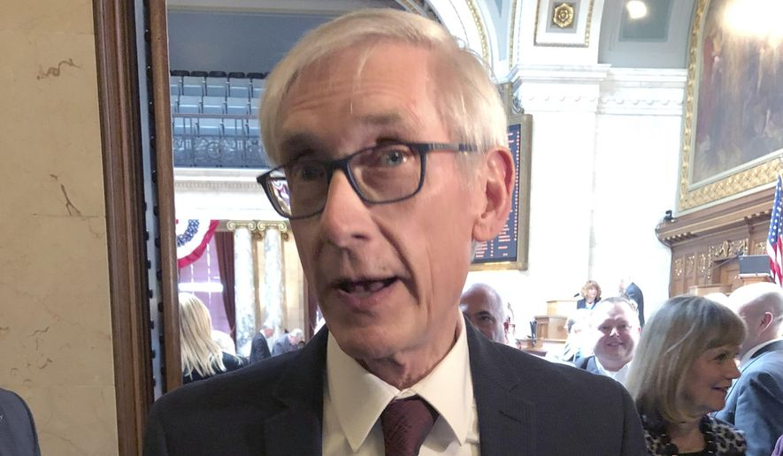 "Wisconsin Gov. Tony Evers tells reporters that the Republican Senate leader is ""huffing and puffing"" for saying confirmation of Evers' Cabinet secretaries is in jeopardy because of an ongoing legal fight over a lame-duck legislative session on Tuesday, April 9, 2019, in Madison, Wisconsin. (AP Photo/Scott Bauer)"
