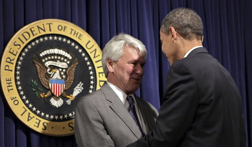 President Barack Obama, right, greets Greg Craig, left, his choice for White House counsel, as he meets with senior staff to assert expectations on ethics and conduct, at the Eisenhower Executive Office Building in the White House complex in Washington, Wednesday, Jan. 21, 2009. (AP Photo/J. Scott Applewhite) ** FILE **