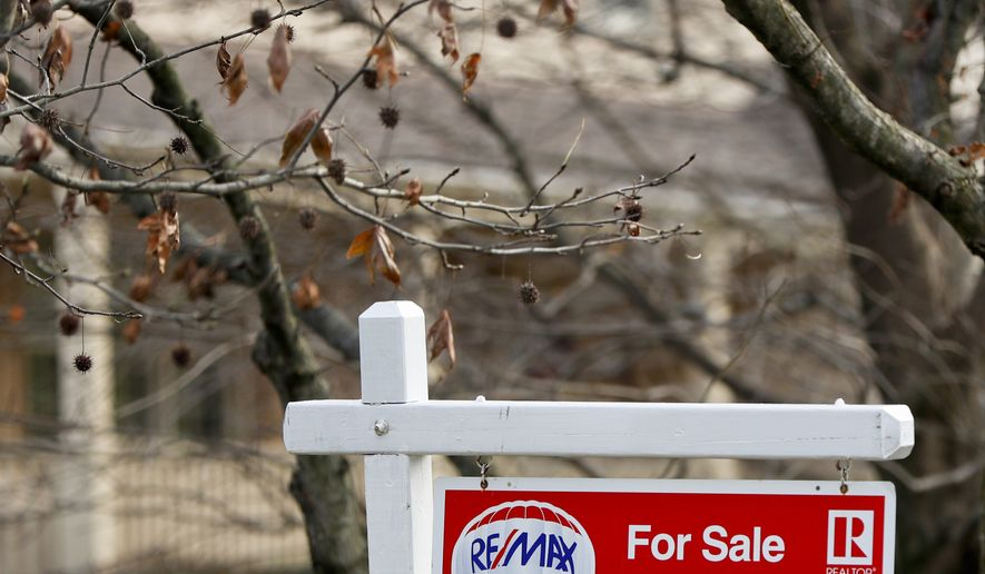 In this Jan. 3, 2019, file photo a Realtor sign marks a home for sale in Franklin Park, Pa. On Tuesday, Jan. 22, the National Association of Realtors reports on sales of existing homes in December. (AP Photo/Keith Srakocic, File)