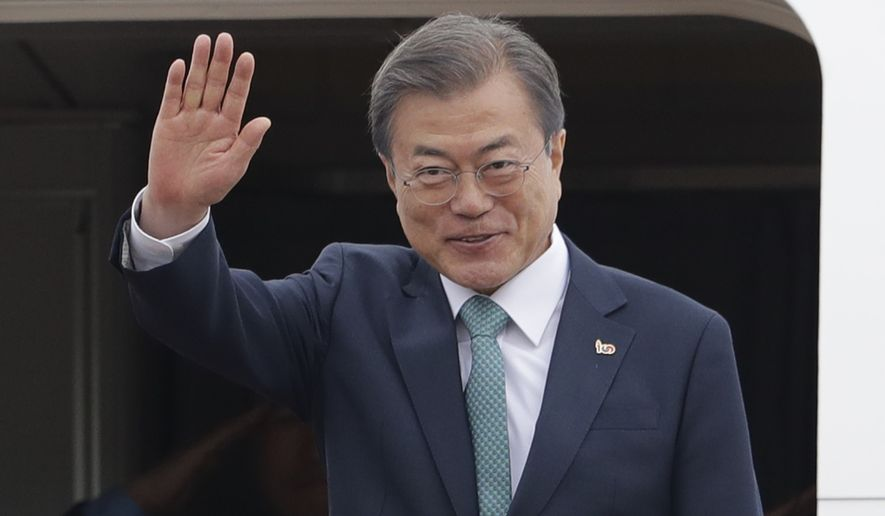 South Korean President Moon Jae-in waves before leaving for the United States at Seoul Air Base in Seongnam, South Korea, Wednesday, April 10, 2019. Moon will meet with U.S. President Donald Trump. (AP Photo/Lee Jin-man)