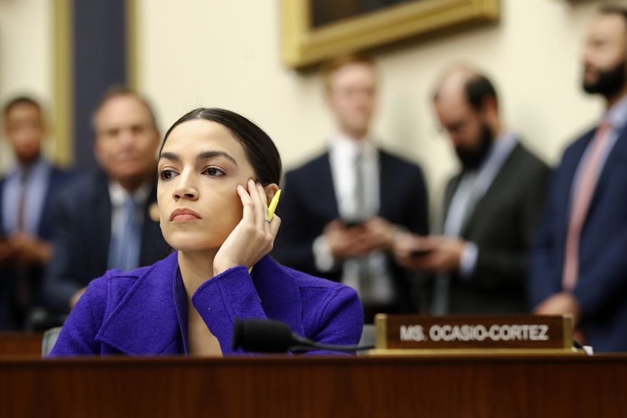 Rep. Alexandria Ocasio-Cortez, D-N.Y., listens during a House Financial Services Committee hearing with leaders of major banks, Wednesday, April 10, 2019, on Capitol Hill in Washington. (AP Photo/Patrick Semansky) **FILE**