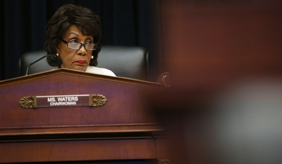 House Financial Services Committee chairwoman Maxine Waters, D-Calif., listens during a hearing with leaders of major banks, Wednesday, April 10, 2019, on Capitol Hill in Washington. (AP Photo/Patrick Semansky)