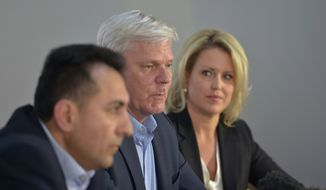From left, Fidel Narvaez, former consul of Ecuador to London, and Kristinn Hrafnsson, editor-in-chief of WikiLeaks, and barrister Jennifer Robinson take part in a press briefing for WikiLeaks founder Julian Assange at Doughty Street Chambers, in London, Wednesday, April 10, 2019. Assange hasn't left the Ecuadorian Embassy since August 2012. (Nick Ansell/PA  via AP)