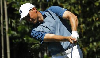 Jordan Spieth hits his tee shot on the third hole during the par-3 golf tournament at the Masters Wednesday, April 10, 2019, in Augusta, Ga. (AP Photo/Matt Slocum)