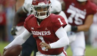 FILE - In this Sept. 22, 2018, file photo, Oklahoma quarterback Kyler Murray (1) carries for a touchdown in the first half of an NCAA college football game against Army in Norman, Okla.  Murray and Nick Bosa are among the 23 prospects who plan to attend the NFL draft this month in Nashville, Tenn. Murray, the Heisman Trophy-winning quarterback, could be selected No. 1 overall by the Arizona Cardinals. Bosa, a defensive end from Ohio State, also is expected to be a top-three pick. (AP Photo/Sue Ogrocki) ** FILE **