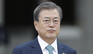 South Korean President Moon Jae-in walks to board a flight leaving for the United States at Seoul Air Base in Seongnam, South Korea, Wednesday, April 10, 2019. Moon will meet with U.S. President Donald Trump. (AP Photo/Lee Jin-man)