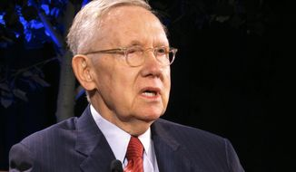 """FILE - In this April 3, 2018, file photo, former Senate Majority Leader Harry Reid speaks during a lecture series at the University of Nevada, Reno. Reid says images of a protester holding a sign with a swastika on it at a recent rally in Nevada for Bernie Sanders are the latest sign of a disturbing rise in anti-Semitism in America. Reid said it was """"embarrassing"""" that someone brought the sign with a swastika to the Henderson rally, noting it came on the heels of other reports of recent hate speech in Nevada, including swastikas found spray painted on a building at the University of Nevada in 2017. (AP Photo/Scott Sonner, File)"""