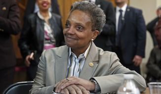 Chicago Mayor-elect Lori Lightfoot smiles during a press conference at the Rainbow PUSH organization, Wednesday, April 3, 2019, in Chicago. (AP Photo/Nuccio DiNuzzo)