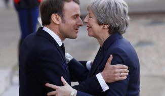 French President Emmanuel Macron,left, greets British Prime Minister Theresa May before a meeting at the Elysee Palace in Paris Tuesday, April 9, 2019. A top official at the French presidency says France doesn't rule out granting a further delay to Brexit, just before a planned meeting between Prime minister Theresa May and President Emmanuel Macron in Paris. (AP Photo/Francois Mori)