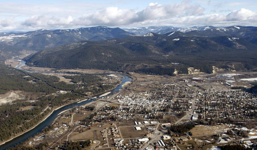FILE - This Feb. 17, 2010, aerial file photo, shows the town of Libby Mont. Environmental officials say a portion of a northwestern Montana town's asbestos cleanup has been completed and will be removed from the federal Superfund list. The 45-acre area removed from the National Priorities List, Wednesday, April 10, 2019, is 5 miles north of downtown Libby, and it is only one of eight units of the Libby Asbestos Superfund site. (AP Photo/Rick Bowmer, File)