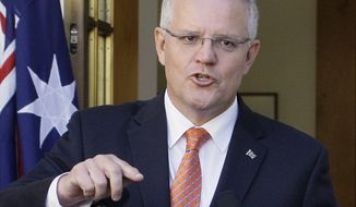 """FILE - In this Feb. 13, 2019, file photo, Australian Prime Minister Scott Morrison addresses the media at Parliament House in Canberra, Australia. Morrison was labeled the """"Accidental Prime Minister"""" when he was thrust to the top of a bitterly divided Australian government facing likely defeat in elections only months away. Since he was elected prime minister in a leadership ballot of colleagues in his conservative Liberal Party on Aug. 24, 2018, Morrison has taken as much time as he had available to repair the government and define his leadership before facing the voters. (AP Photos/Rod McGuirk, File)"""