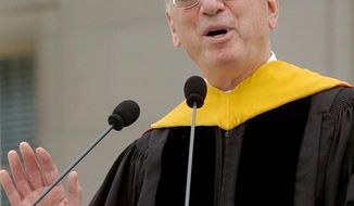 FILE - In this June, 2005, file photo, businessman Irwin Jacobs gives the commencement address at the Massachusetts Institute of Technology in Cambridge, Mass. Authorities are investigating the deaths of two people found at the Lake Minnetonka mansion of Irwin Jacobs, a prominent Minnesota businessman who once owned a minority share in the Minnesota Vikings NFL team. (AP Photo/Lisa Poole, File)