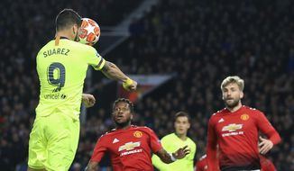 Barcelona's Luis Suarez scores the opening goal of his team during the Champions League quarterfinal, first leg, soccer match between Manchester United and FC Barcelona at Old Trafford stadium in Manchester, England, Wednesday, April 10, 2019. (AP Photo/Jon Super)