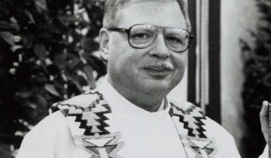 FILE - This 1989 file photo shows Father Arthur Perrault in Albuquerque, N.M. A jury has found a former priest guilty of sexually abusing a boy nearly three decades ago at a veterans' cemetery and Air Force base in New Mexico. The jury reached the verdict Wednesday, April 10, 2019, against Perrault, who had vanished from New Mexico in 1992. He was returned to the United States in September from Morocco to face charges of aggravated sexual abuse and abusive sexual contact. (The Albuquerque Journal via AP, File)