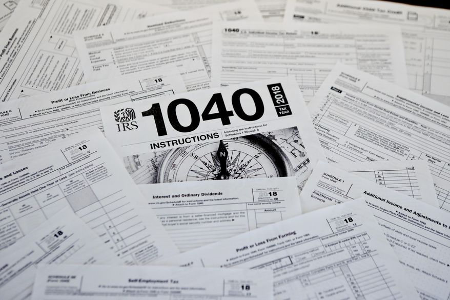 This Feb. 13, 2019, photo shows multiple forms printed from the Internal Revenue Service web page that are used for 2018 U.S. federal tax returns in Zelienople, Pa. The head of the IRS, overseeing the most sweeping overhaul of the U.S. tax codes in three decades, says the average refund in this year's tax-filing season, $2,833, worked out to be close to last year's. Internal Revenue Service Commissioner Charles Rettig told Congress Wednesday that an increase is urgently needed in the agency's budget to modernize antiquated computer systems and protect taxpayers' data. (AP Photo/Keith Srakocic)