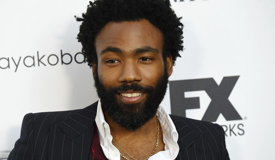 """In this Sept. 16, 2018 file photo, Donald Glover, creator and star of the FX series """"Atlanta,"""" and a musician who performs under the name Childish Gambino, poses at a private cocktail party to celebrate the FX network's Emmy nominations in Los Angeles. (Photo by Chris Pizzello/Invision/AP, File)"""
