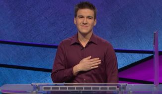 "This image made from video aired on ""Jeopardy!"" on Tuesday, April 9. 2019, and provided by Jeopardy Productions, Inc. shows James Holzhauer.  The 34-year-old professional sports gambler from Las Vegas won more than $110,000 on ""Jeopardy!"" on Tuesday, breaking the record for single-day cash winnings. (Jeopardy Productions, Inc. via AP) ** FILE **"