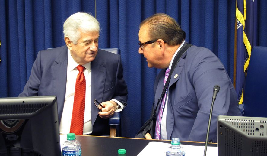Senate President John Alario, R-Westwego, left, speaks with House Speaker Taylor Barras, R-New Iberia, after a meeting of the state's Revenue Estimating Conference on Wednesday, April 10, 2019, in Baton Rouge, La. The conference broke through a logjam and adopted increased income forecasts that will give lawmakers more money to spend in the legislative session. (AP Photo/Melinda Deslatte)