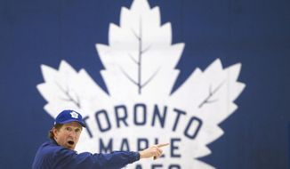 Toronto Maple Leafs NHL hockey team head coach Mike Babcock runs drills during practice in Toronto,Monday, April 8, 2019. The Maple Leafs take on the Boston Bruins in the first round of the Stanley Cup playoffs. (Nathan Denette/The Canadian Press via AP)