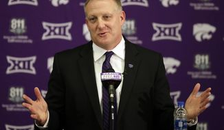 FILE - In this Dec. 12, 2018, file photo, new Kansas State NCAA college football head coach Chris Klieman speaks at his introductory press conference in Manhattan, Kan. Kansas State is starting to open things up under new coach Chris Klieman, shedding a bit of the shroud of secrecy that longtime coach Bill Snyder had developed. Parts of practice are open to reporters, the coaching staff has embraced social media, and the result is a palpable buzz around what had been a stagnating program. (AP Photo/Orlin Wagner, File)