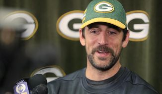 Green Bay Packers quarterback Aaron Rodgers speaks to members of the media at Lambeau Field on Wednesday, April 10, 2019, in Green Bay, Wis. (Adam Wesley/The Post-Crescent via AP)